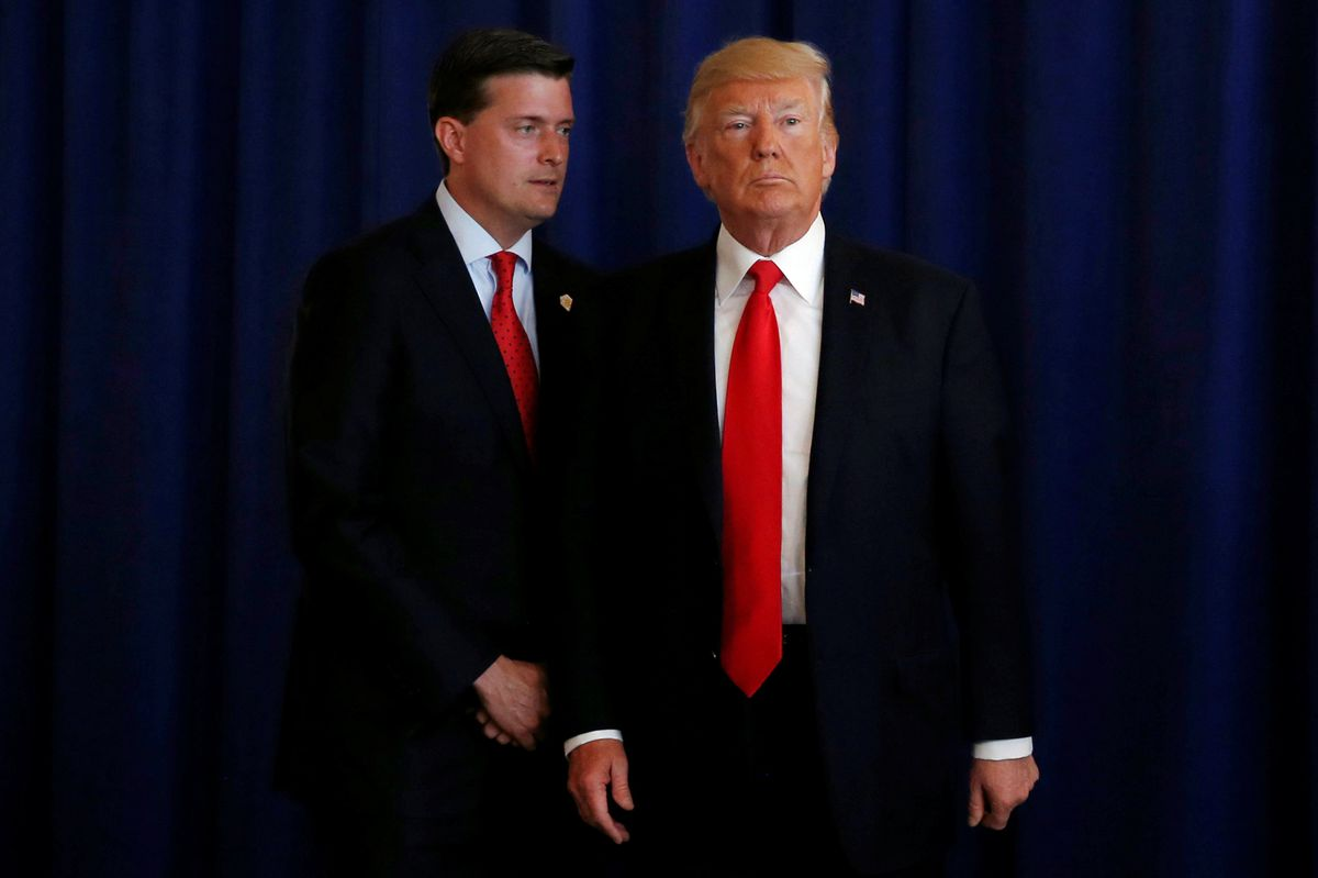 FILE: White House Staff Secretary Rob Porter with President Donald Trump in Bedminster, New Jersey, August 12, 2017. REUTERS/Jonathan Ernst