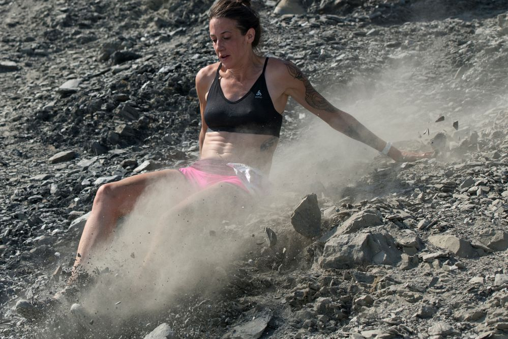 Kellyn Brothis, of Parker, Colorado, stumbles during the Mount Marathon women's race on July 4, 2019, in Seward. (Marc Lester / ADN)