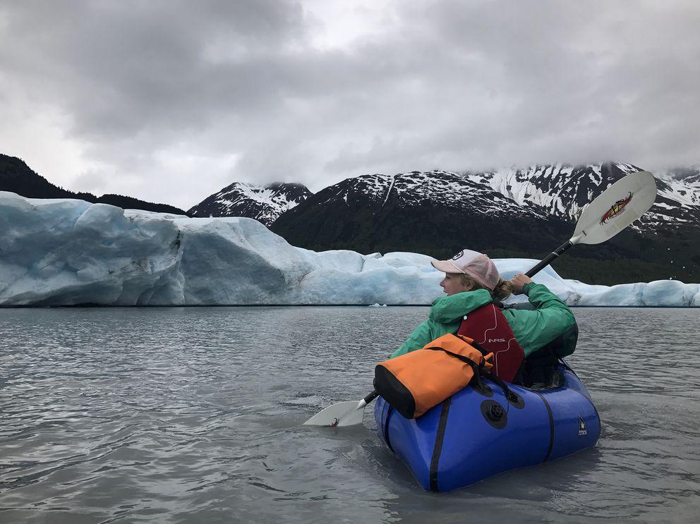 Devin Kelly paddles on the lake at the toe of Spencer Glacier on Monday, June 12, 2017. (Vicky Ho / Alaska Dispatch News)