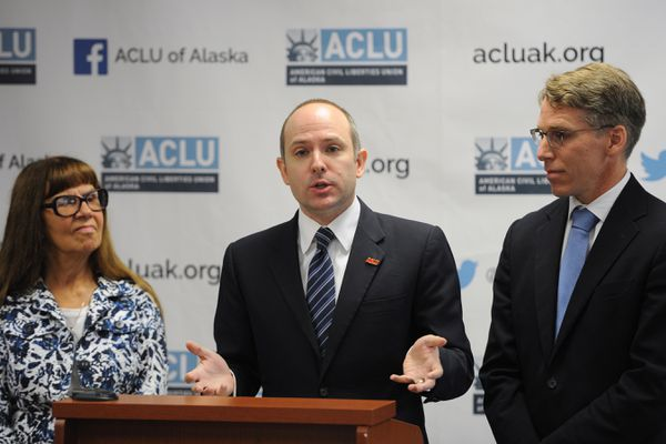 Joshua Decker, executive director of American Civil Liberties Union of Alaska, center, with plaintiffs Bonnie Jack and John Kauffman announced a lawsuit that has been filed against Gov. Dunleavy to reverse his