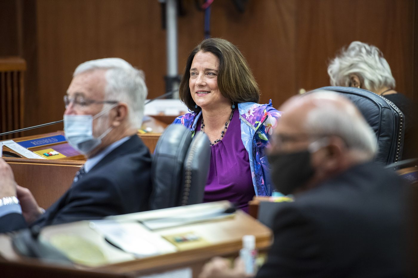 Sen. Lora Reinbold, R-Eagle River, center, goes maskless as Senators take their seats at the Capitol under new health mandates on Monday, May 18, 2020, as they consider Gov. Mike Dunleavy's proposed use of federal Covid-19 money. (Photo by Michael Penn)