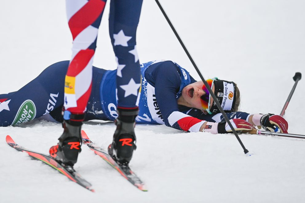 Second placed Rosie Brennan of Anchorage collapses after finishing Sunday's 10K pursuit in Val Mustair, Switzerland. (Gian Ehrenzeller/Keystone via AP)