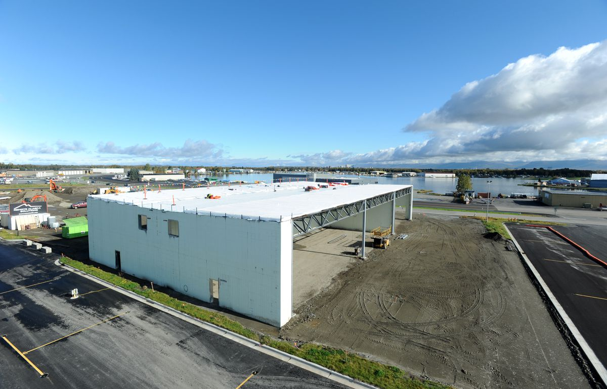 The first of three buildings in the Lake Hood Hangars complex is under construction on Tuesday. (Erik Hill / Alaska Dispatch News)