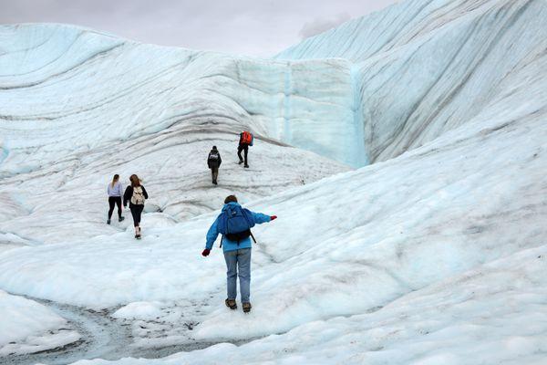 Guided visitors explore Root Glacier on Saturday, June 27, 2015, near Kennecott. The glacier joins the Kennicott Glacier near the Kennecott Mine site in Wrangell St. Elias National Park and Preserve. (Erik Hill / Alaska Dispatch News)
