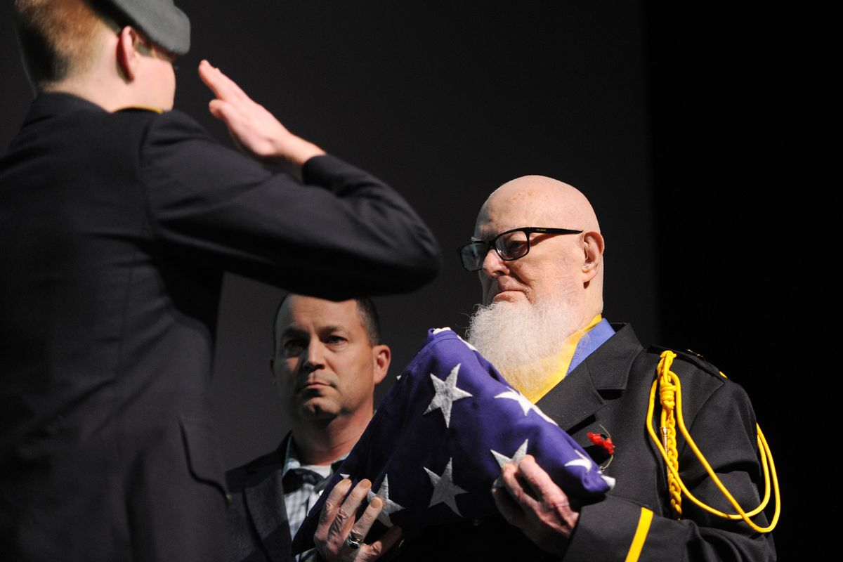 Walter Fergus, a WWII POW and Vietnam War veteran, was presented a folded U.S. Flag honoring him for his service to the country during a Veterans Day ceremony in the Glenn Massay Theater at Mat-Su College on Monday, Nov. 11, 2019. (Bill Roth / ADN