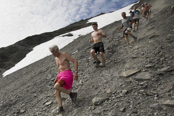 Fred Moore, left, of Seward, competes in the Mount Marathon men's race on July 4, 2018. (Loren Holmes / ADN)