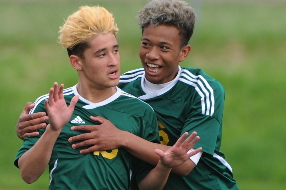 Service High's Alex Nunez and Noah Mason celebrate a header goal scored by Nunez during the state soccer championships at Service High School on Thursday, May 23, 2019. (Bill Roth / ADN)