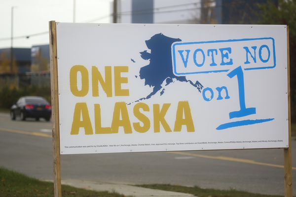 A sign opposing ballot measure one, which proposes an oil tax increase, rests on the side of King Street in Anchorage on Oct. 8, 2020. (Emily Mesner / ADN)
