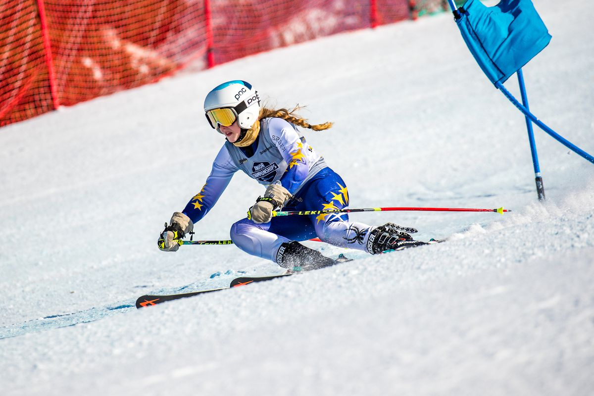 Alyeska Ski Club racer Piper Sage brushes past a gate en route to her victory Friday in the girls giant slalom race at the Western Region U16 Championships at Alyeska Ski Resort. (Photo by Bob Eastaugh)