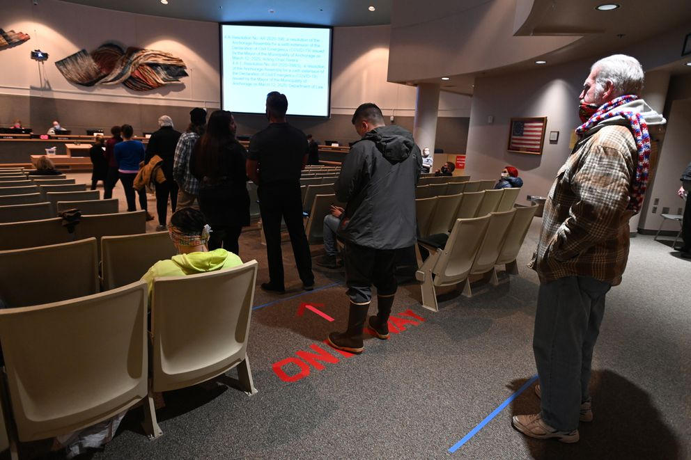 People wait in line to testify during a special meeting of the Anchorage Assembly on Monday, Nov. 16, 2020. (Bill Roth / ADN)