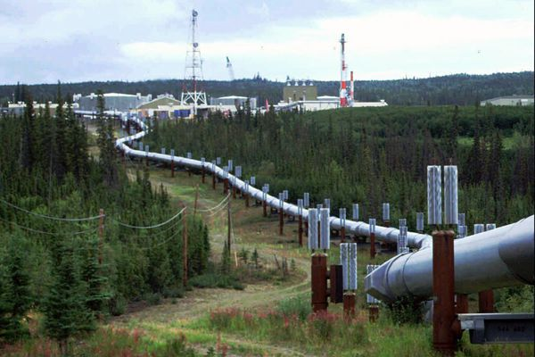 FILE - This undated file photo shows the Trans-Alaska pipeline and pump station north of Fairbanks, Alaska. For decades, Alaska has had an uneasy reliance on oil, building budgets around its volatile boom-or-bust nature. When times were rough, prices always seemed to rebound, forestalling a day of reckoning some believe may finally have come. The situation has politicians weighing changes to the annual dividend paid to residents from earnings of the state's oil-wealth fund, the Alaska Permanent Fund. (AP Photo/Al Grillo, File)