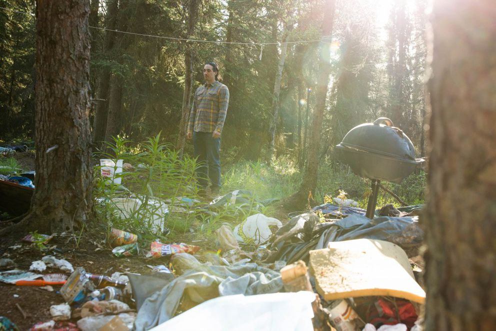 Zack Hicks, a clinician with CHOICES Inc, a community mental health provider, visits a homeless camp along the Chester Creek greenbelt on Wednesday, Jun. 1, 2016.  (Loren Holmes / Alaska Dispatch News)