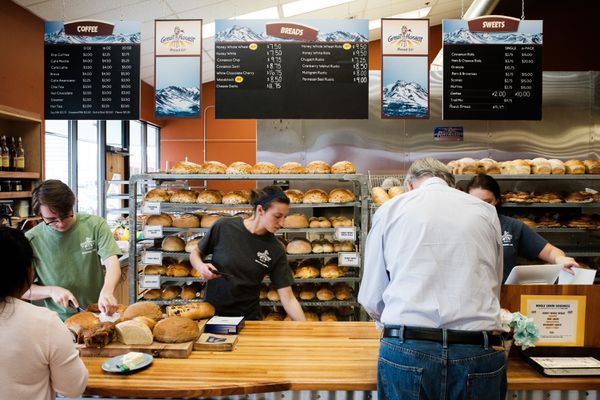 Anna Grant (middle) works behind the counter to serve patrons of Great Harvest Bread Co. bread samples on August 17, 2017. (Young Kim / Alaska Dispatch News)