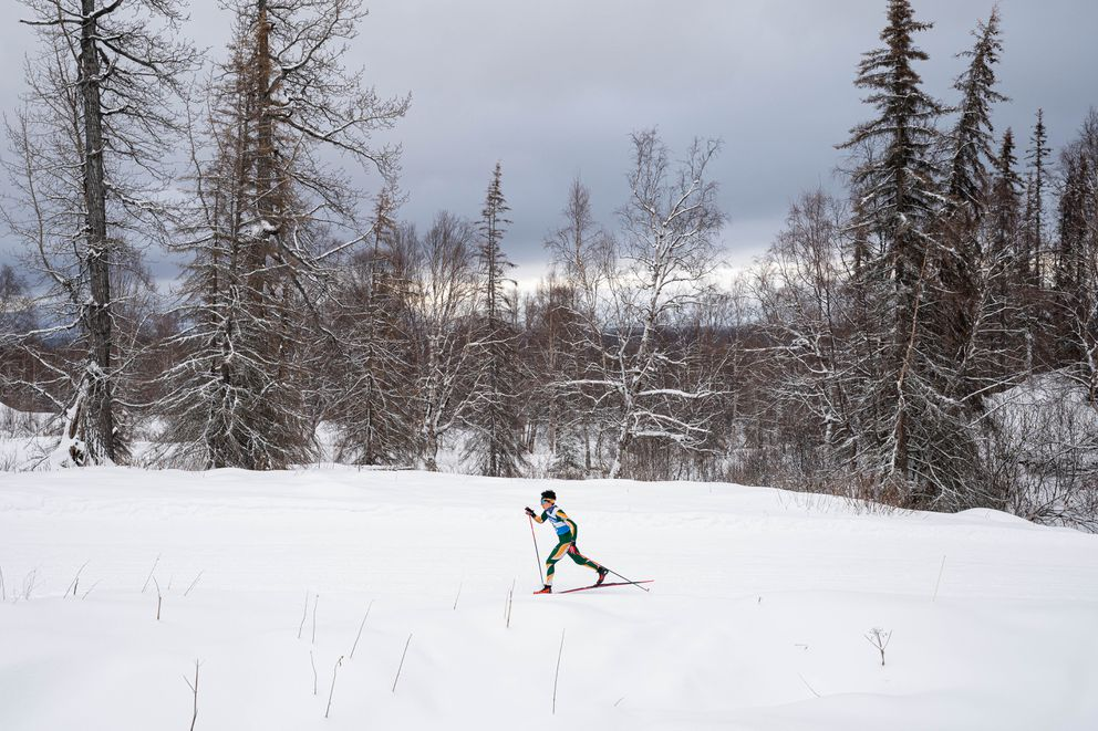 Service's Joel Power skis through the woods on his way fourth place in the boys 7.5K. (Loren Holmes / ADN)