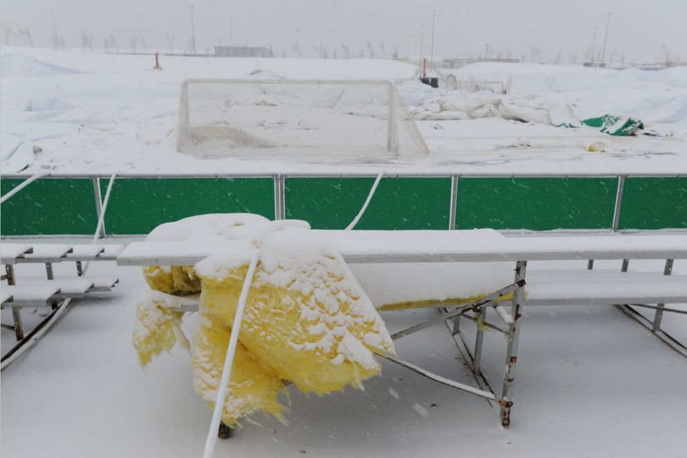 Insulation, bleachers and a soccer goal were coated with snow Monday after the Anchorage sports dome collapsed over the weekend, exposing some of itsinterior.(Bill Roth / Alaska Dispatch News)
