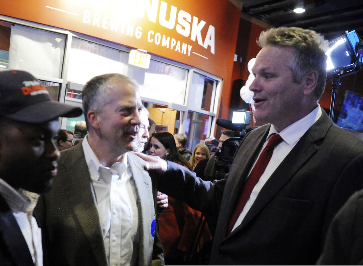 Republican gubernatorial candidate Mike Dunleavy, right, greets Sen. Dan Sullivan Tuesday, Nov. 6, 2018 In Anchorage, Alaska. (AP Photo/Michael Dinneen)
