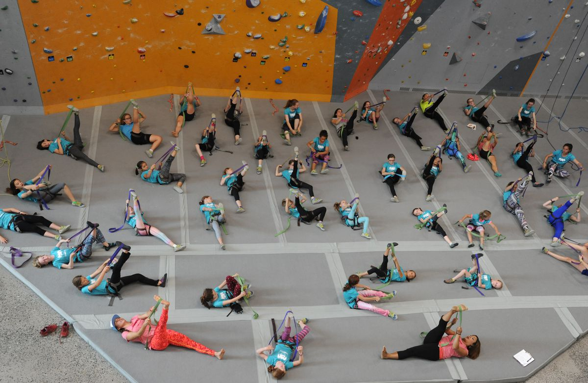Girls ages 8 to 18 warm-up before participating in a Fast and Female event Thursday at the Alaska Rock Gym. (Bill Roth / Alaska Dispatch News)
