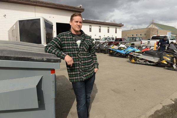 Chad Winberg stands next to the dumpster at his A2D Motorsports shop in south Anchorage, AK on Friday April 20, 2018. Someone dropped a water heater and boxes off at his dumpster and Winberg found who did it and returned the water heater to his driveway. (Bob Hallinen / ADN)
