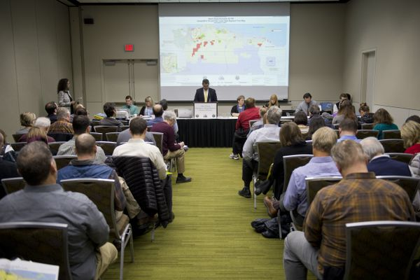 Jim Beckham, deputy director of the Division of Oil and Gas, announces bids. Alaska's Division of Oil and Gas hosted an oil and gas lease sale for the North Slope and Beaufort Sea regions at the Dena'ina Convention Center in Anchorage on Dec. 6, 2017. (Marc Lester / ADN)