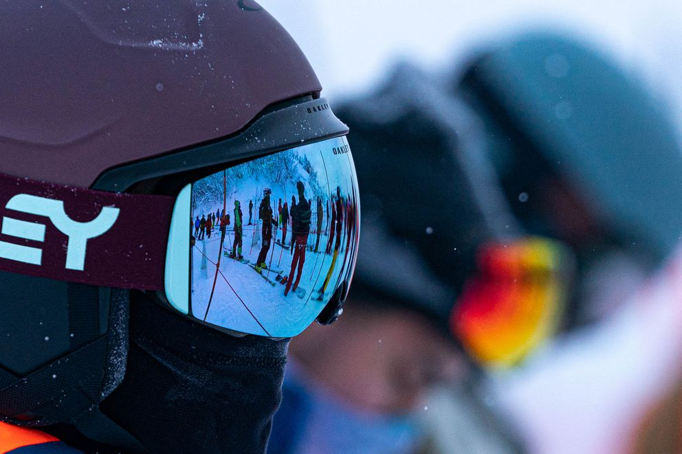 Face masks are as common as goggles in lift lines at Alyeska. (Loren Holmes / ADN)