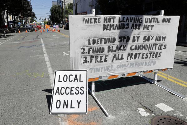 A sign on a street barricade lists some of the demands of protesters in what has been named the Capitol Hill Occupied Protest zone in Seattle, Monday, June 22, 2020. For the second time in less than 48 hours, there was a shooting near the