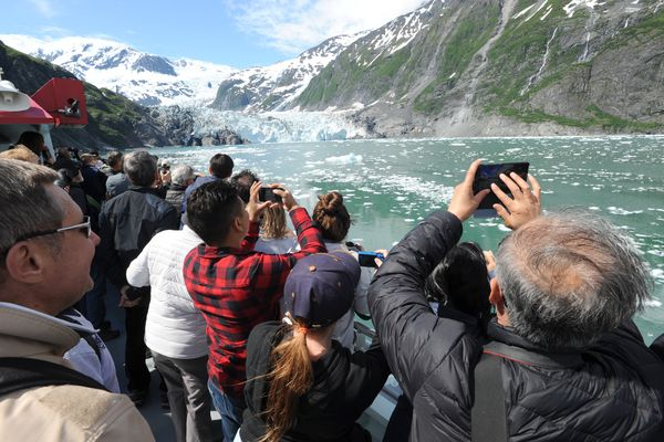Tourists aboard the Klondike Express take photos of Surprise Glacier in Prince William Sound, Thursday, June 13 , 2019. (Anne Raup / ADN)