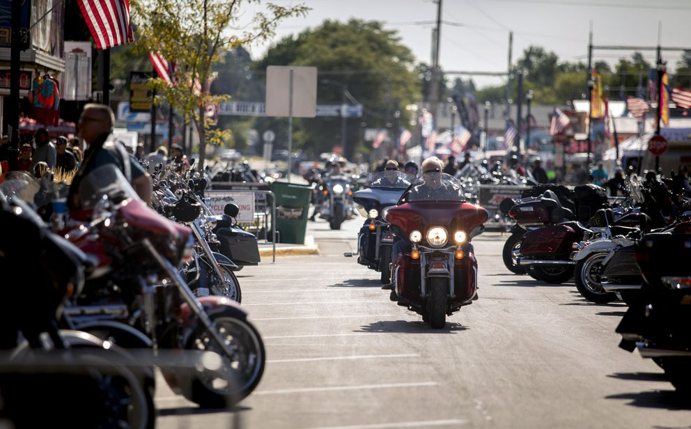 People ride through downtown Sturgis, S.D., during the 80th annual Sturgis Motorcycle Rally on Monday, Aug. 10, 2020. (Grace Pritchett/Rapid City Journal via AP)