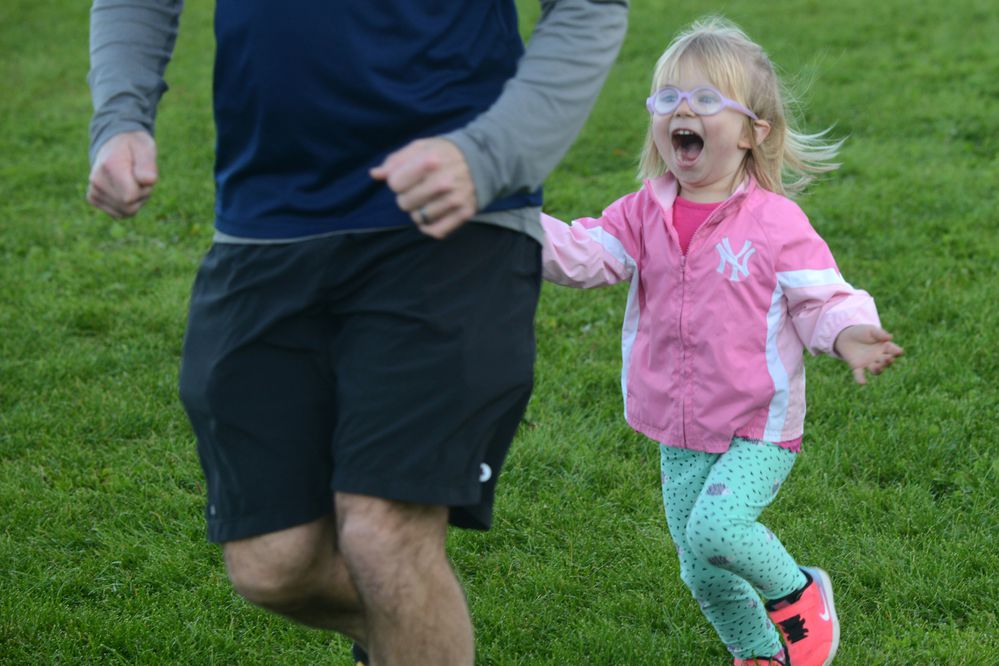 Ross Timm and 2-year old Emilia Timm come into the finish line after completing the Munchkin Course at the Tuesday Night Race at Russian Jack Springs Park North in Anchorage, Alaska on Tuesday, Sept. 19, 2017. (Bob Hallinen / Alaska Dispatch News)