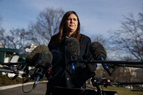 White House press secretary Sarah Huckabee Sanders talks with reporters outside the White House, Friday, Jan. 25, 2019, in Washington. (AP Photo/ Evan Vucci)