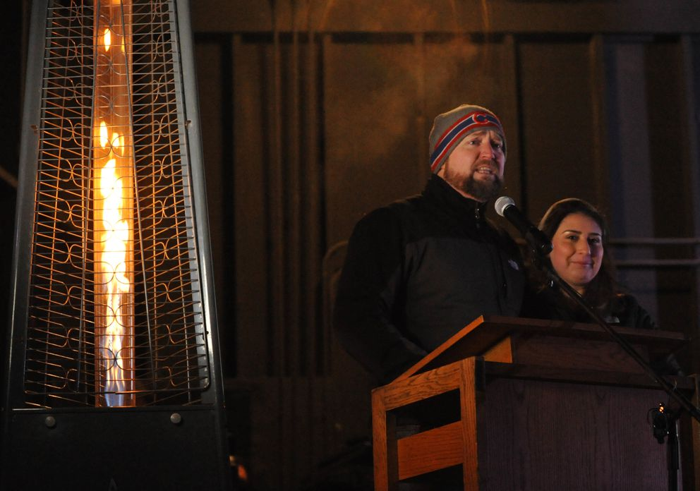 Adam Mokelke and his daughter Victoria Mokelke speak at a candlelight vigil for David Grunwald at the Borealis Theater at the Alaska State Fair grounds in Palmer on Friday. Victoria was the girlfriend of slain teenager Grunwald. (Bob Hallinen / Alaska Dispatch News)
