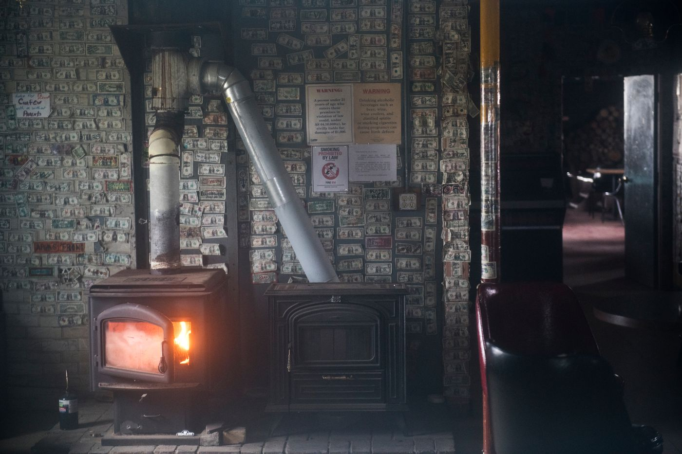 A fire burns in the stove, but the Safety Roadhouse stood closed on a Sunday afternoon. (Marc Lester / ADN)