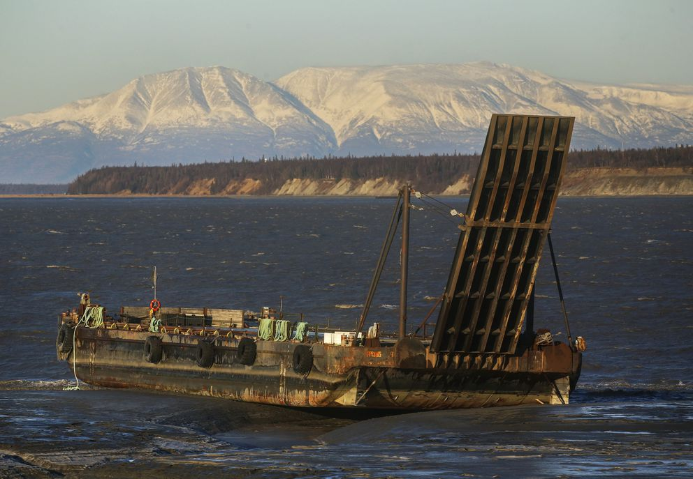 A deck barge, owned by Cook Inlet Tug & Barge, is beached on the mudflats along Knik Arm, just north of Westchester Lagoon, after it broke loose in strong winds in Anchorage around 8 a.m. on Nov. 2, 2020. (Emily Mesner / ADN)