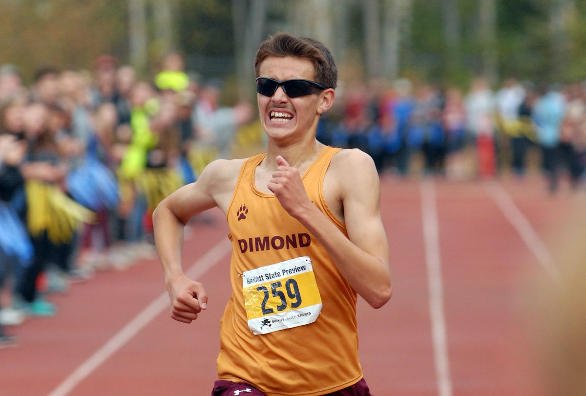 Dimond's Sonny Prosser crosses the finish line to win the boys varsity race at the Bartlett State Preview Cross Country Meet on Saturday, Aug. 31, 2019 at Bartlett High. Prosser finished the 5-kilometer course in 15 minutes, 6.2 seconds to break the course record set by Kodiak's Levi Thomet in 2014. (Matt Tunseth / ADN)
