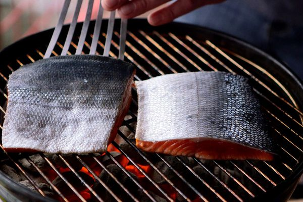 When grilling sockeye salmon, start with the skin side up to retain moisture while cooking. (Tara Young / ADN)