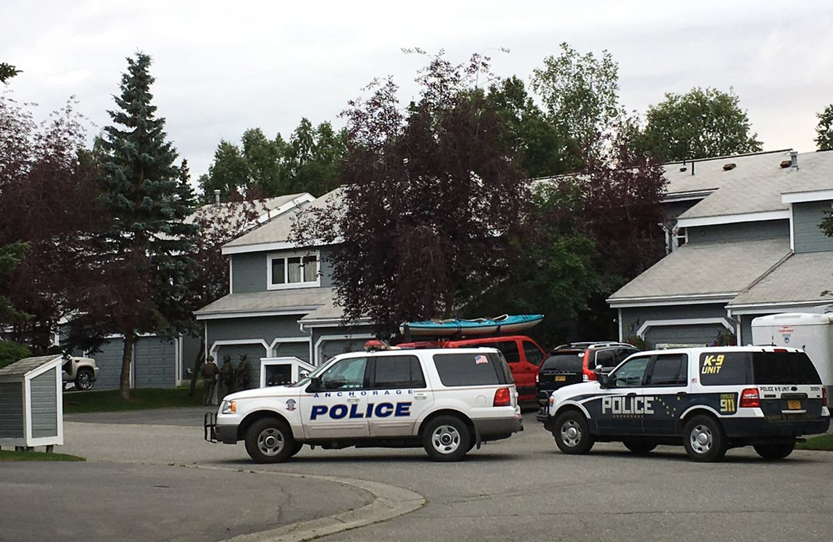 Anchorage police asked people to avoid the area near East Northern Lights Boulevard and Cimarron Circle as SWAT officers served warrants Tuesday. (Jerzy Shedlock / Alaska Dispatch News)