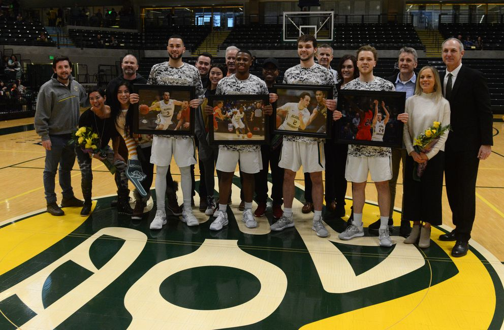 UAA's seniors were joined by family members at midcourt during a pregame ceremony. (Photo by Bob Hallinen)