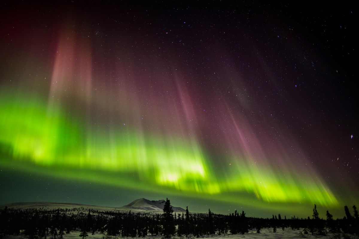 Seen from Gunsight Mountain near Eureka, a coronal mass ejection from the sun created stunning northern lights a few days later as the particles passed by Earth on March 16, 2013. (Loren Holmes / Alaska Dispatch News)