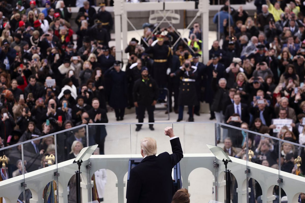 President Donald Trump, newly sworn in as the 45th president of the United States, raises a fist at the U.S. Capitol in Washington on Friday. (Damon Winter/The New York Times)