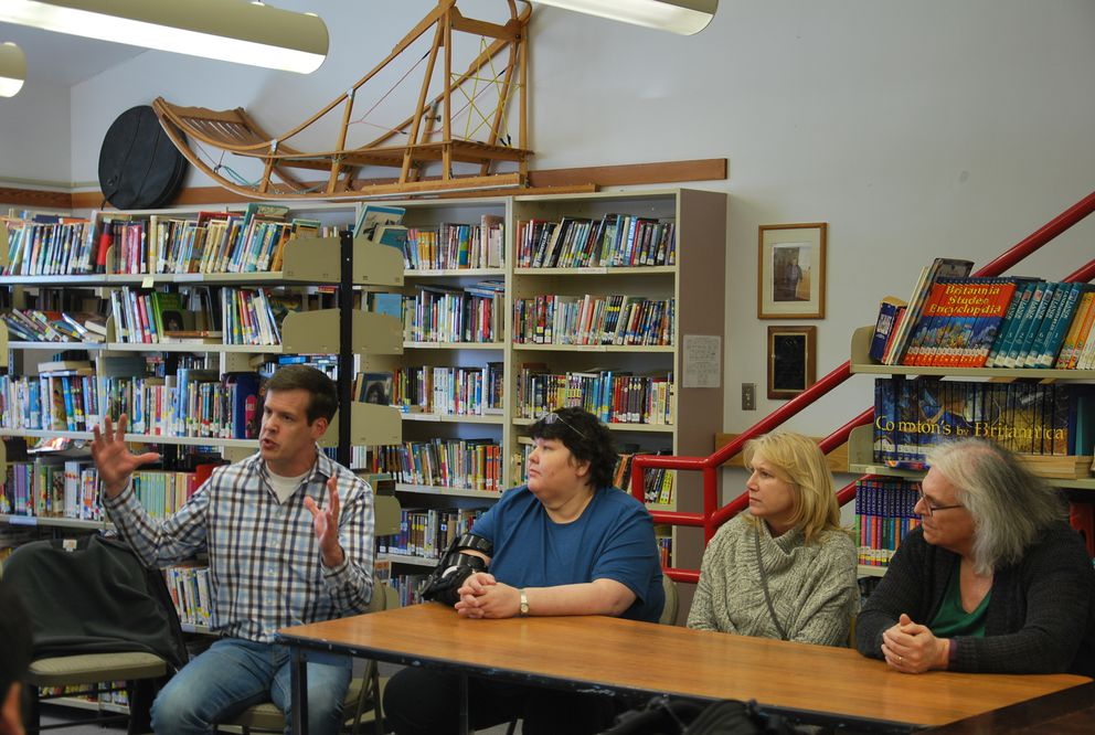LPSD Superintendent Ty Mase (far left) discusses the subsistence calendar in Newhalen. On his left is Lake and Peninsula School Board member Gerda Kosbruk, Lake and Peninsula Borough Assistant Finance Officer Nikki Reed, and Lake and Peninsula Borough Finance Officer Susan Edwards. (Lawrence Hamilton / KDLG)