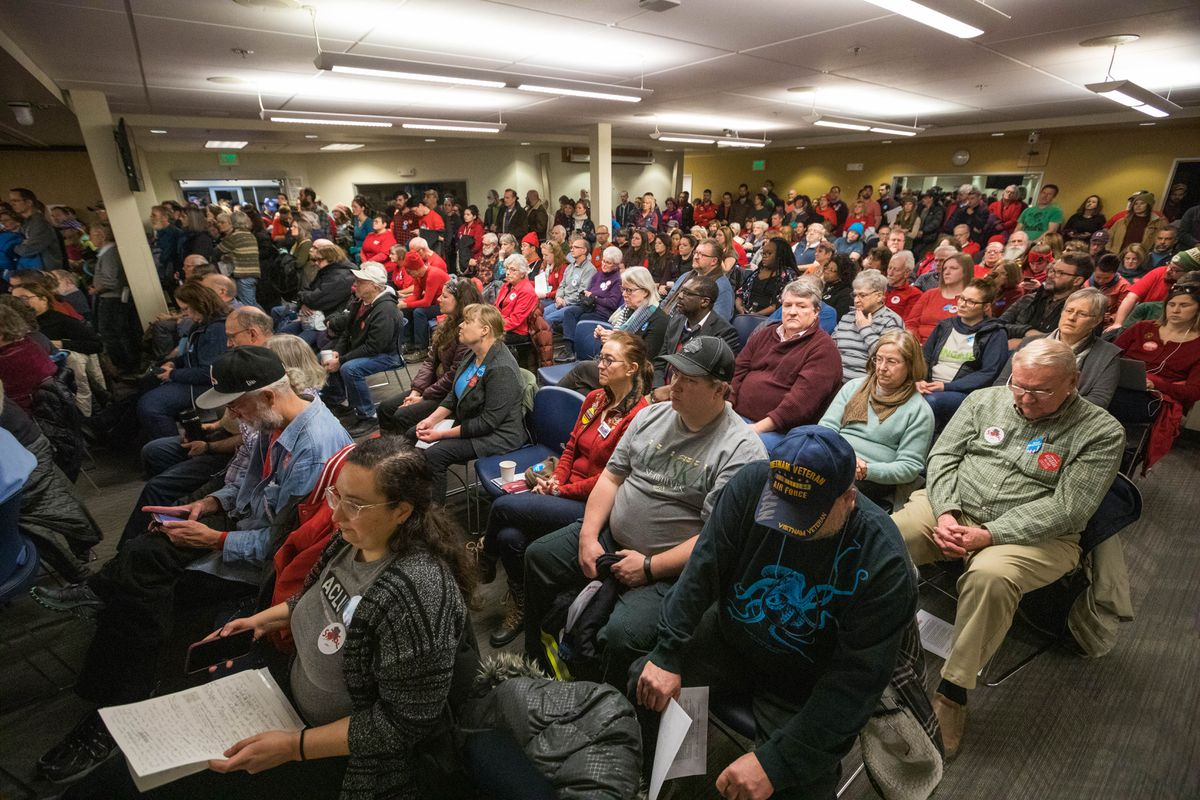 Over 300 people filled an Anchorage School District meeting room on Saturday, Feb. 23, 2019 for a state budget town hall. A bipartisan group of 15 lawmakers from both legislative houses listened for an hour as constituents — packed so tightly into the room that the Fire Marshal would only allow the crowd to stay if all the doors were kept open — voiced their frustration with state government. (Loren Holmes / ADN)