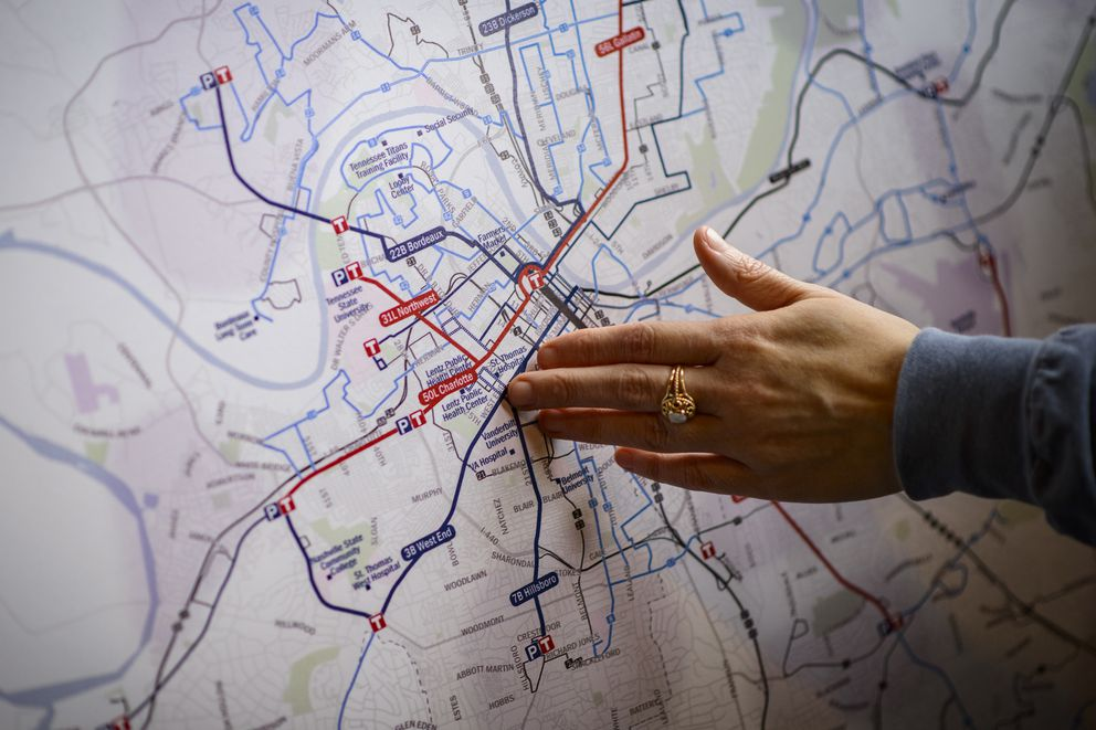 Mary Beth Ikard, transportation and sustainability manager for Nashville, points to a map of the proposed transit system at Jackalope Brewing Company in Nashville, Tenn., March 25, 2018. In communities across the country, the billionaire conservative Koch brothers are waging a sophisticated fight against new rail projects and bus routes. (William DeShazer/The New York Times)