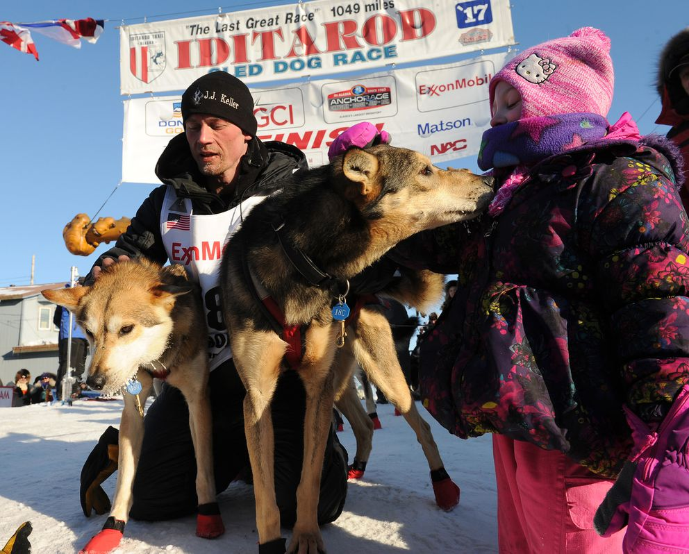 Dallas Seavey with his lead dogs Reef and Tide at the Iditarod finish line in Nome, March 14, 2017. (Bob Hallinen / Alaska Dispatch News)