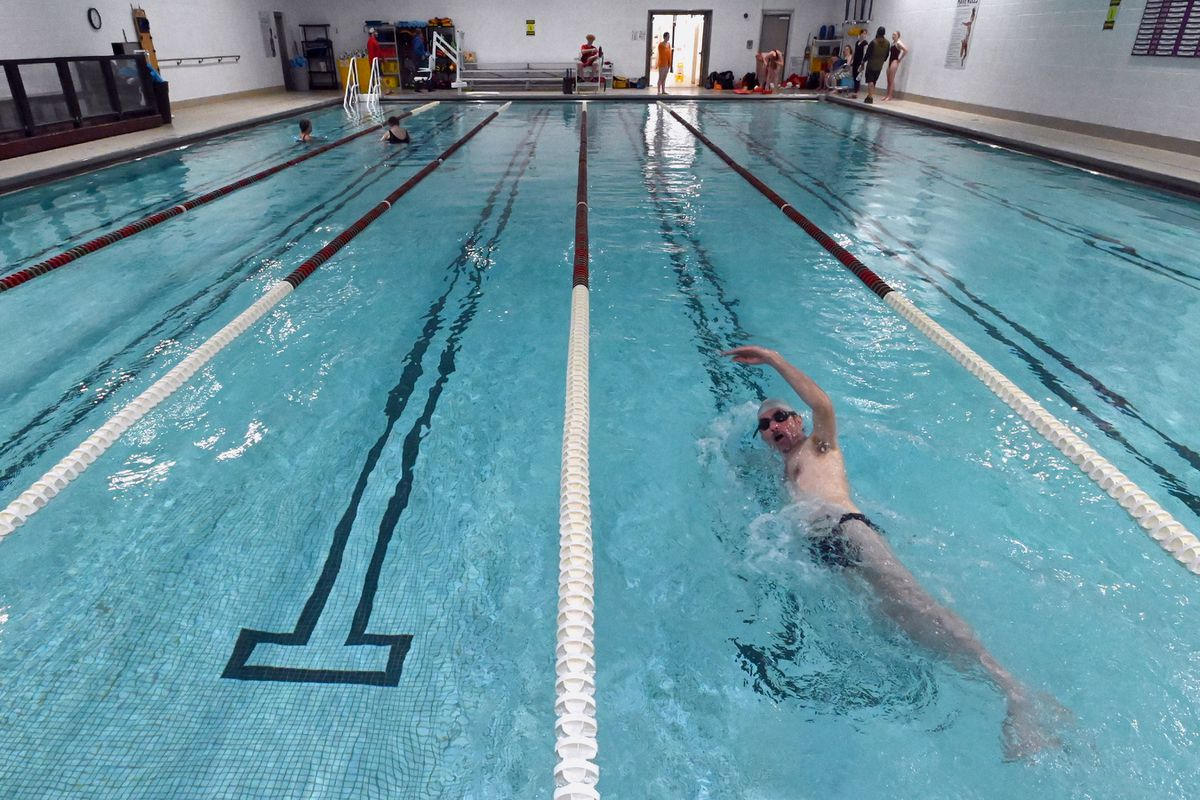 Joey Peacott swam laps at the YMCA of Alaska on Lake Otis Parkway during COVID-19 pandemic. (Bill Roth / ADN)