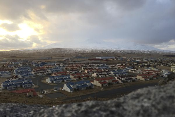 In this April 2015 photo, the buildings of the former Adak Naval Air Facility sit vacant in Alaska. The Trump administration is considering using West Coast military bases or other federal properties as transit points for shipments of U.S. coal and natural gas to Asia. (Julia O'Malley/Alaska Daily News via AP)