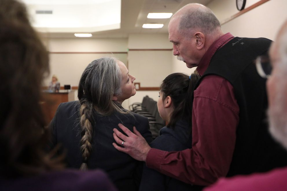 Edie and Ben Grunwald share a moment after the verdicts for Dominic Johnson were read Thursday afternoon. Victoria Mokelke, David Grunwald's girlfriend, is between the Grunwalds. (Loren Holmes / ADN)