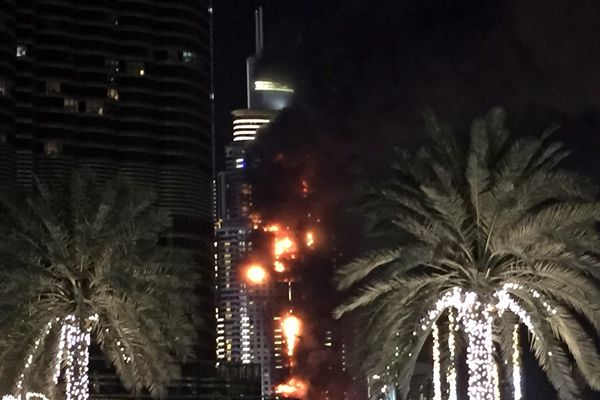 A fire runs up some 20 stories of a building in Dubai, United Arab Emirates, Thursday, Dec. 31, 2015. The fire broke out Thursday in a residential building near Dubai's massive New Year's Eve fireworks display. It was not immediately clear what caused the fire near the Burj Khalifa, the world's tallest skyscraper at 828 meters (905 yards).