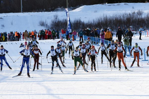 Racers at the start of the girls varsity race at Kincaid Park on Saturday, Feb. 1, 2020. (Matt Tunseth / Chugiak-Eagle River Star)