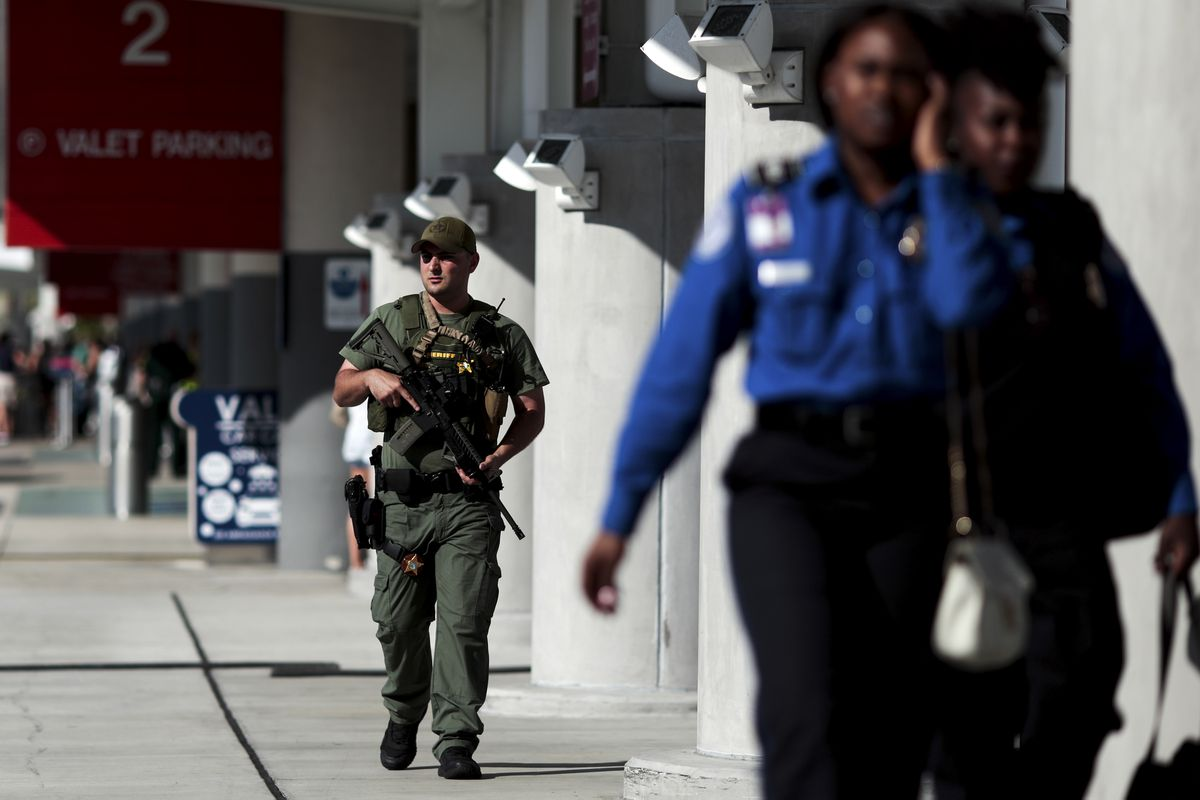 A Broward County sheriff's deputy patrols the Fort Lauderdale-Hollywood International Airport in Fort Lauderdale, Fla., Jan. 7, 2017. On Jan. 6, a gunman, identified as Esteban Santiago, opened fire at the airport, killing five people and injuring eight. (Scott McIntyre/The New York Times)