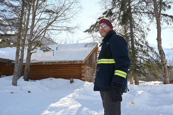 Dan Winter, a 2020 retiree from BP, volunteers at the Eagle River Nature Center on Thursday mornings. His wife, Sharon, has been volunteering there for months. They cleared snow and ice from the nature center's roof and split firewood March 5, 2020. (Anne Raup / ADN)