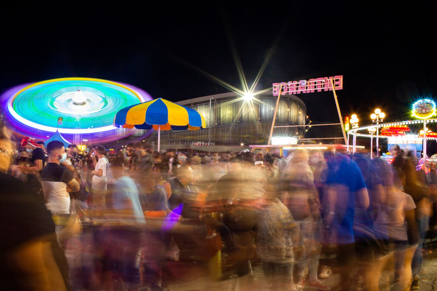 While votes were counted inside the Arizona Veterans Memorial Coliseum in early May, the Crazy Times Carnival at the Arizona State Fair went on outside. Photo by Washington Post by Courtney